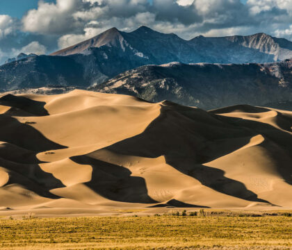 Discover the best sand dunes in the US from California to North Carolina including the Great Sand Dunes National Park the Outer Banks, & more.