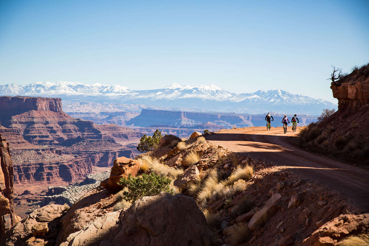 Plan your mountain biking trip on the White Rim Trail in Canyonlands National Park. Learn about permits, itineraries, gear, campsites & more.