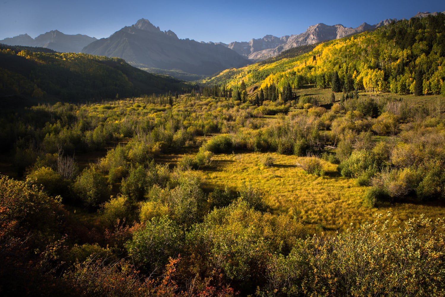 Sneffels Range // Experience vibrant fall Colorado foliage with this road trip itinerary that takes you through some of the best aspen groves in the state.