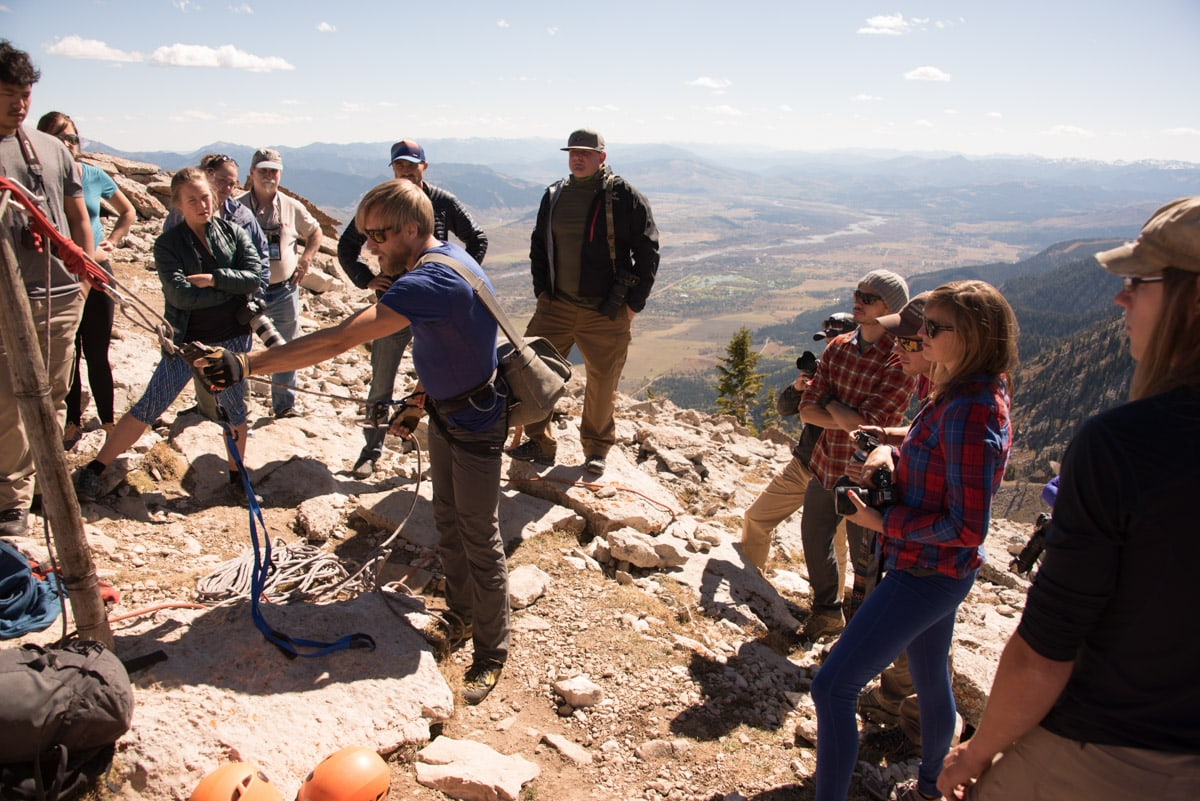 Learning how to get on the ropes take climbing photos from pro-photographer Ben Moon at Jackson Hole Mountain Resort