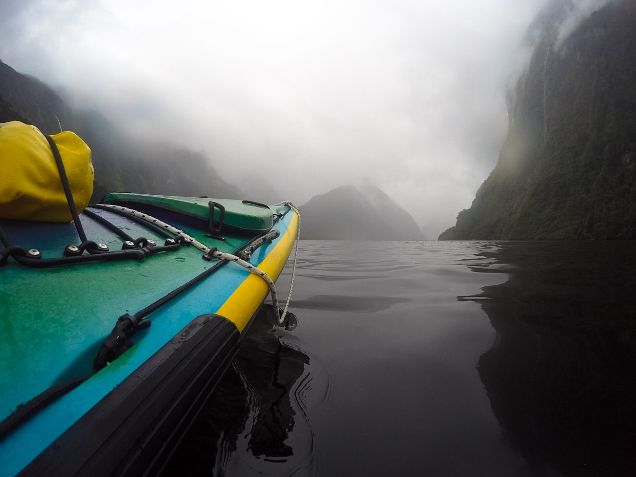 Experimenting with perspective by holding the GoPro low to the water in New Zealand's Doubtful Sound // Learn my favorite GoPro tips and tricks to improve your travel photography.
