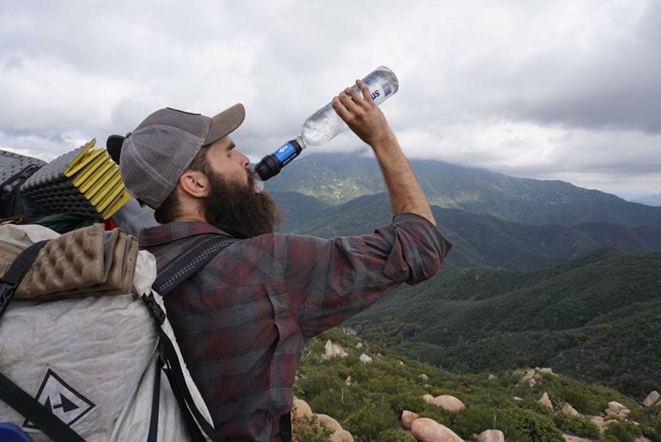 Learn what to consider when choosing a backpacking water filter & get recommendations for the most popular, lightweight & easiest water filters available // Sawyer Squeeze Water Filter