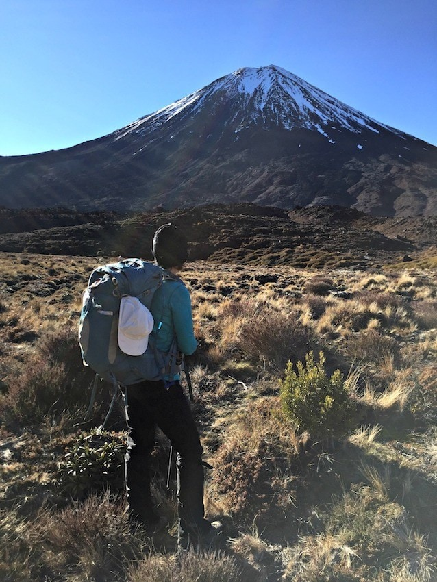 Don't miss New Zealand's best day hike. Get this detailed hiking & gear guide for the Tongariro Crossing hike featuring volcanic landscapes & emerald lakes.