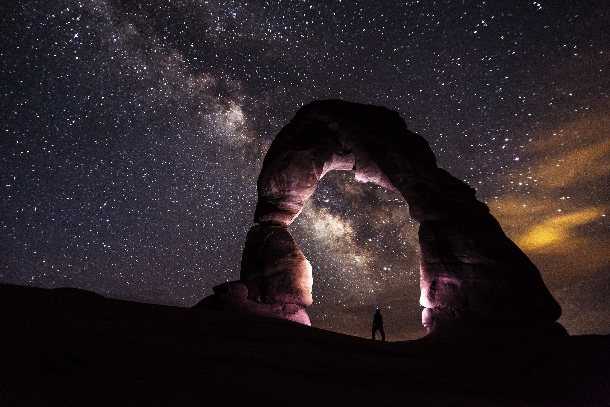 Delicate Arch under the night sky // A round-up of the best hikes in Utah. Explore Utah's epic landscapes and get tips for tackling these bucketlist trails.