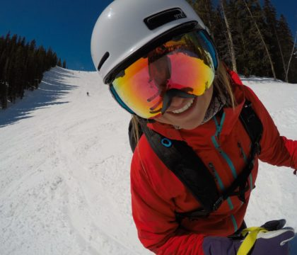 What to wear skiing - the ultimate guide to skiing apparel so you have the right clothes for staying warm, dry, and comfortable on the slopes.