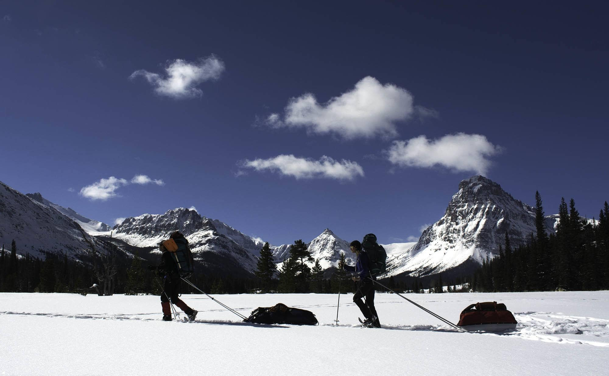 Winter camping in Glacier National Park // From hot springing to dog sledding to skijoring, get outside on your Montana vacation with these 8 adventurous winter activities.