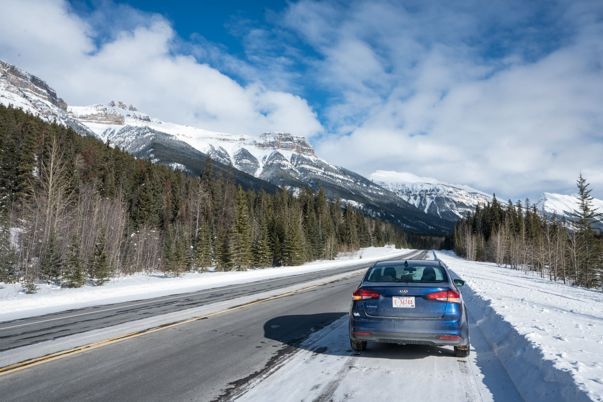 Icefields Parkway // Plan the ultimate winter getaway in the Canadian Rockies. This 4-day Jasper National Park winter itinerary gives you an adventurous day-by-day plan, including skiing at Marmot Basin, dog sledding, fat biking, the Maligne Canyon Icewalk, plus info on how to get to Jasper, the best restaurants & where to stay.