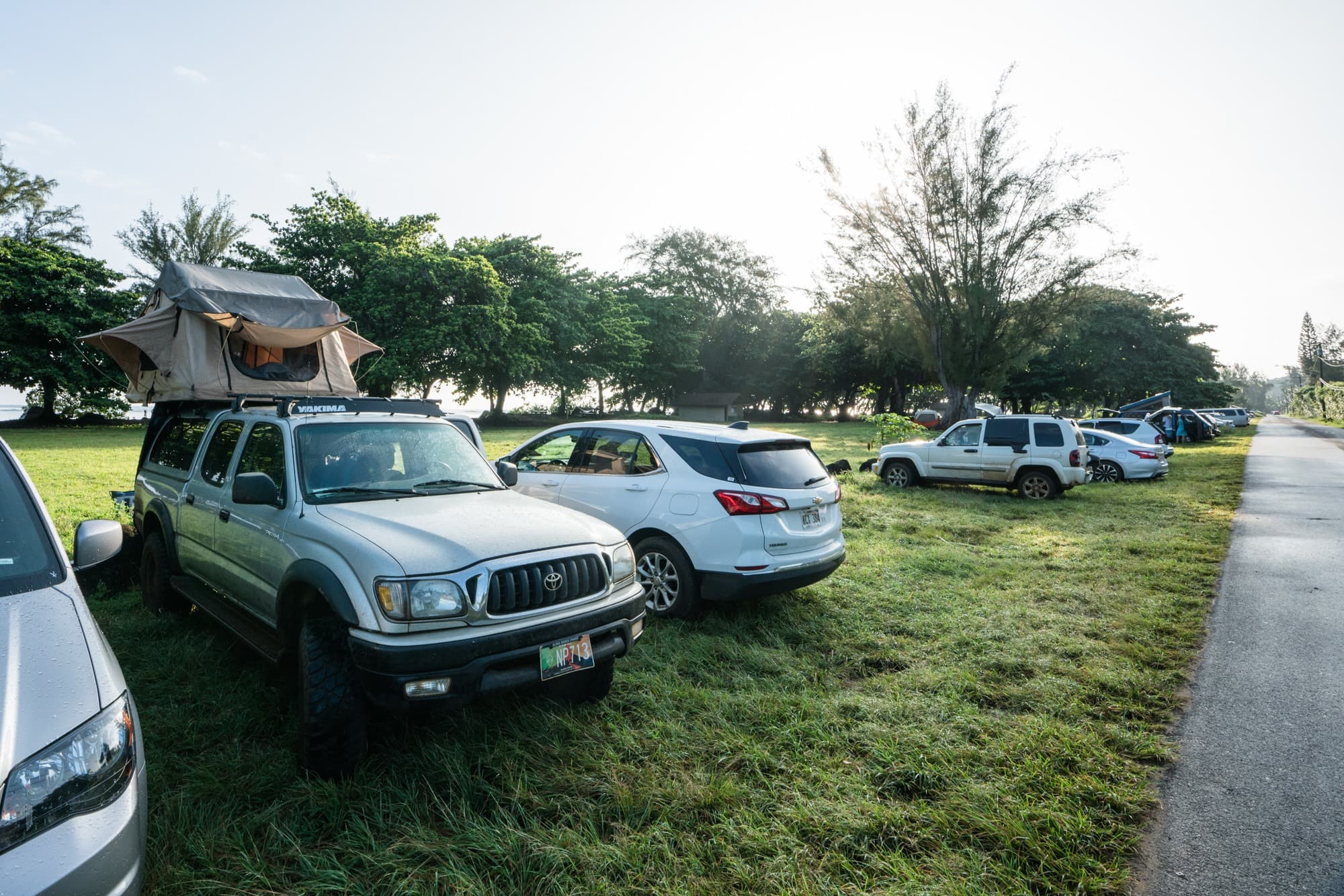 Camping at Anini Beach // Thinking about renting a 4x4 truck camper or VW-style campervan on Kauai? Read about my vanlife experiences during a recent Kauai vacation. Learn the beach campgrounds where it is legal to sleep in your car, and see if renting campervan is the right choice for your Kauai adventures.