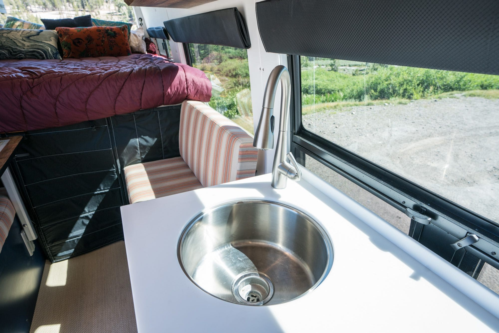 """Sprinter Van sink // Tour Bearfoot Theory's Outside Van Sprinter Van conversion. This 4x4 170"""" Sprinter camper has everything you need for off-the-grid vanlife adventures."""
