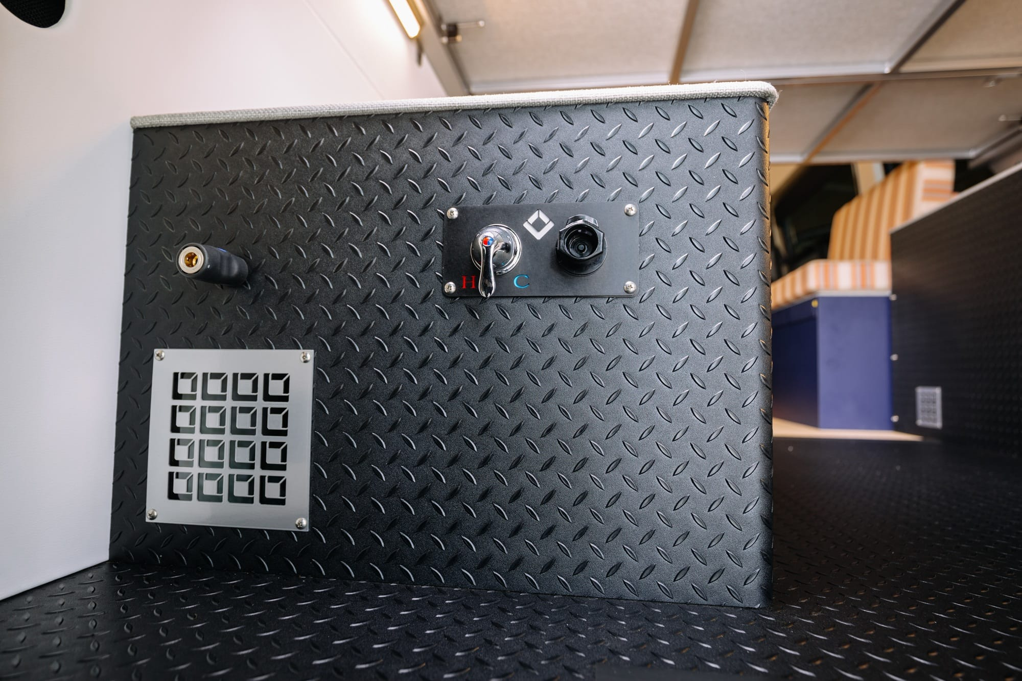 """Water tanks in Sprinter Van // Tour Bearfoot Theory's Outside Van Sprinter Van conversion. This 4x4 170"""" Sprinter camper has everything you need for off-the-grid vanlife adventures."""