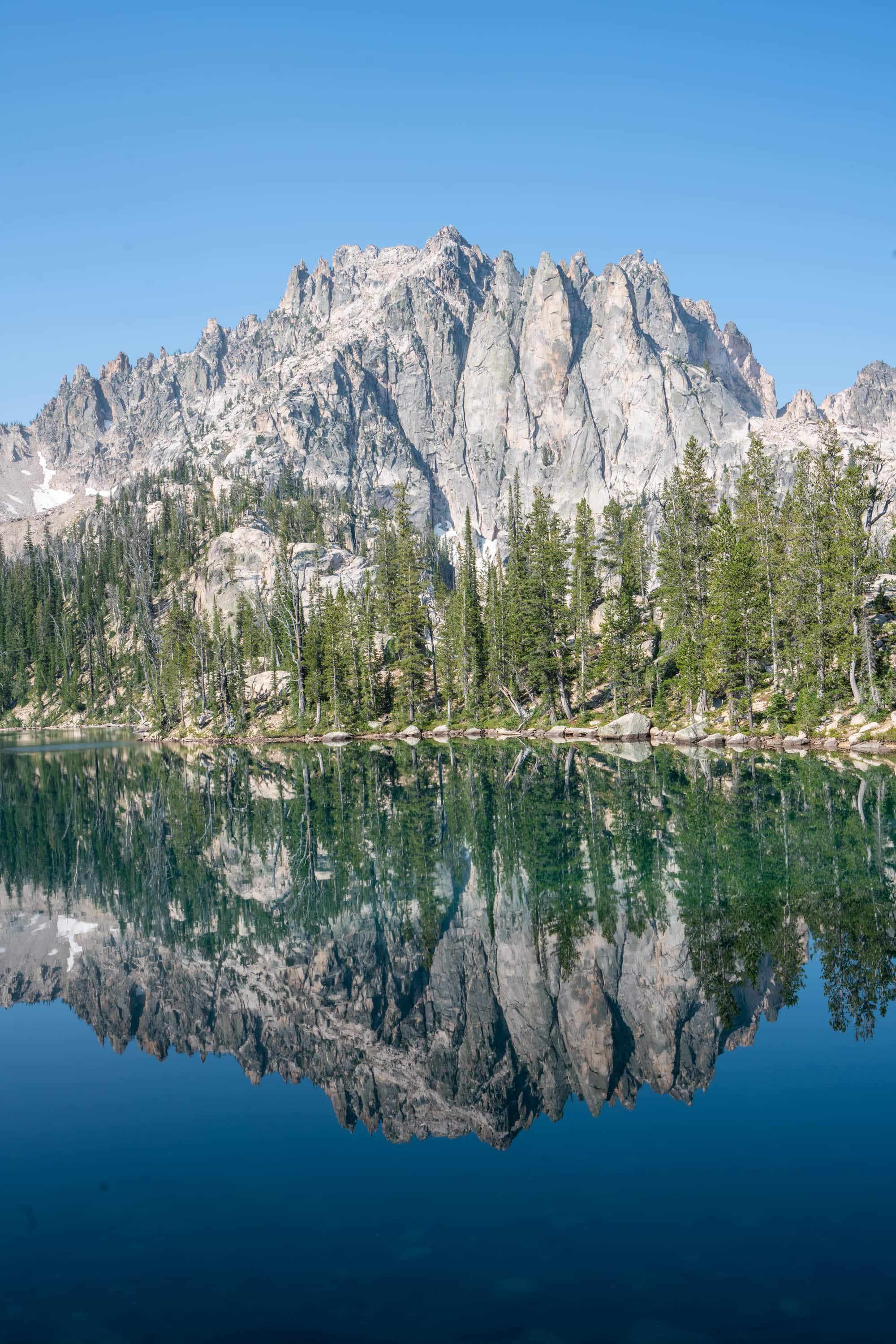 Baron Lakes is one of those iconic hikes in Idaho's Sawtooth Mountains with several high alpine lakes to choose from and wide open views of the jagged Sawtooth Range.  Get my hiking, trail, and campsite tips with this detailed Baron Lakes backpacking guide.