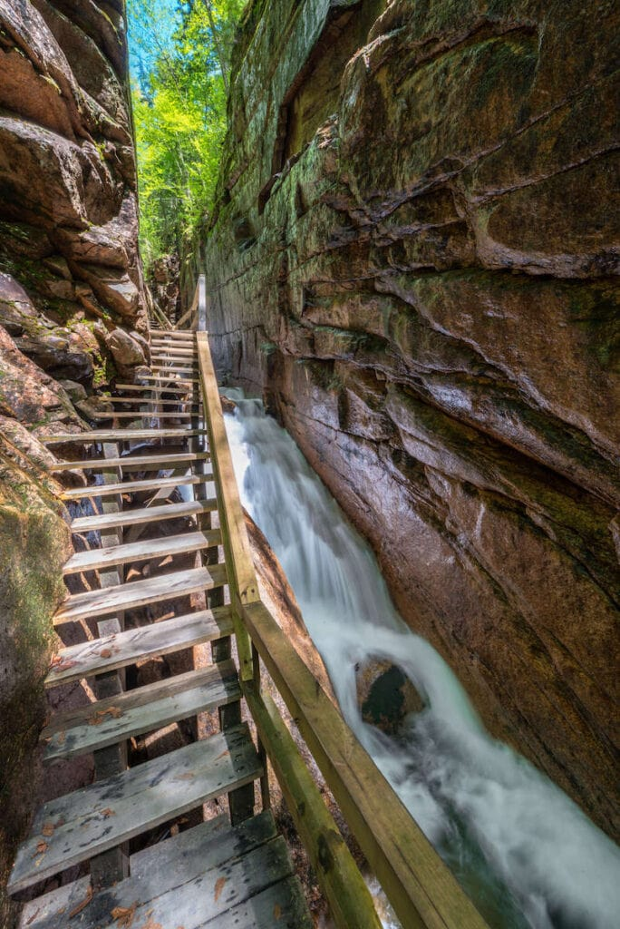 Flume Gorge // Discover the 5 most scenic White Mountains waterfall hikes in New Hampshire including how to get there and what to expect along the trail.