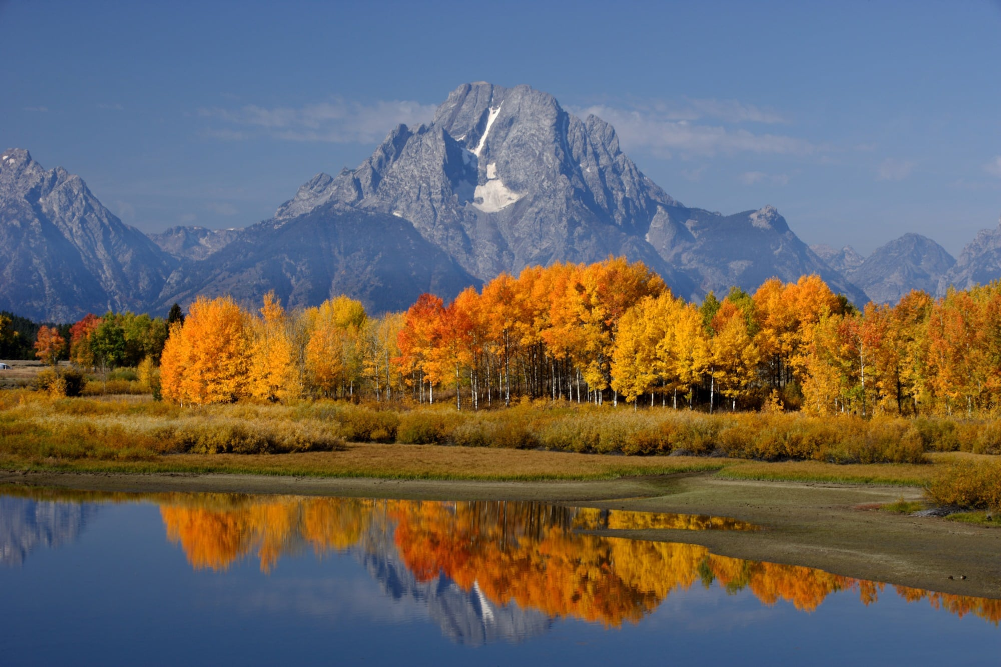 Grand Teton National Park // Discover the best National Parks to visit during fall for the best leaf-peeping vacation. Get tips on hikes, scenic drives, and more.
