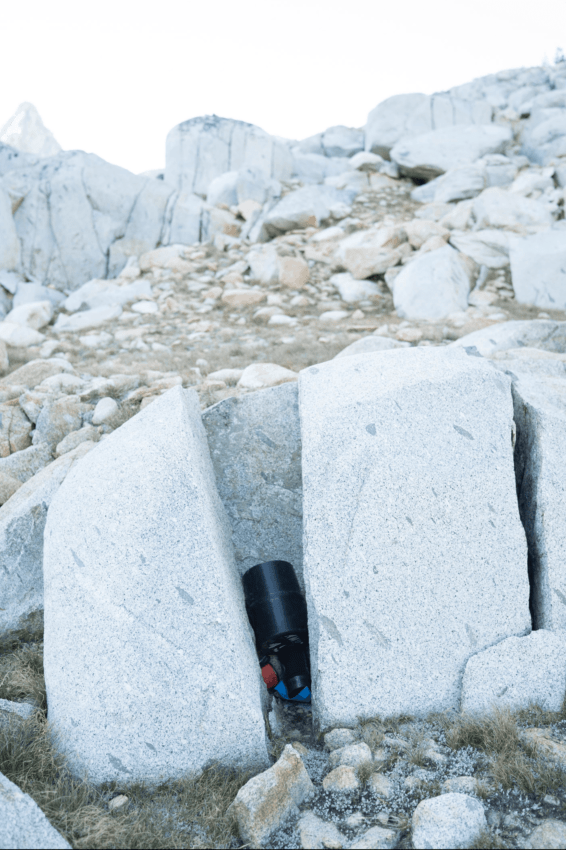 When backpacking in bear country, wedge your bear canister between rocks or trees if possible so it won't roll away.