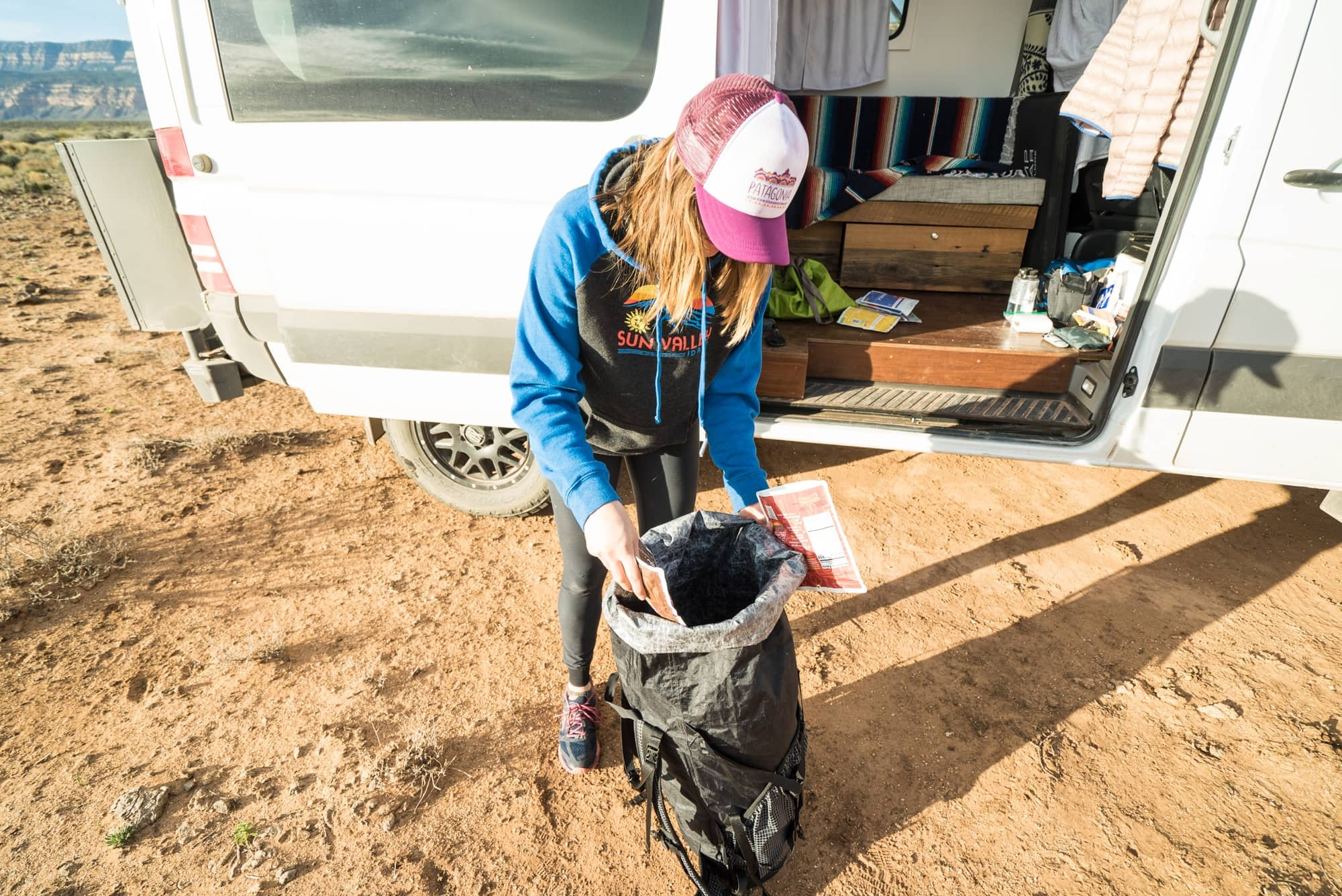Kristen packing her backpacking pack // Learn how to pack a backpacking pack for maximum comfort and organization with these tips for fitting your gear and balancing the load.