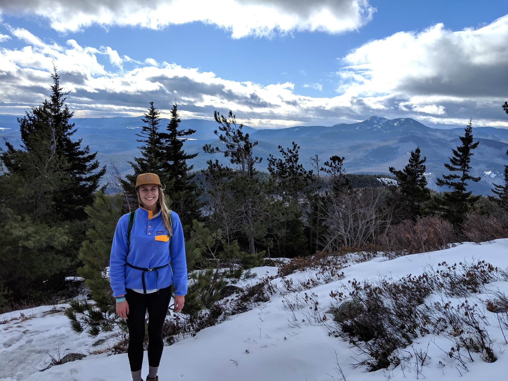 Looking for a hike in New Hampshire? Our trail guide to hiking South Mount Mountain in the winter includes what to bring, 3 ways to get there & more.