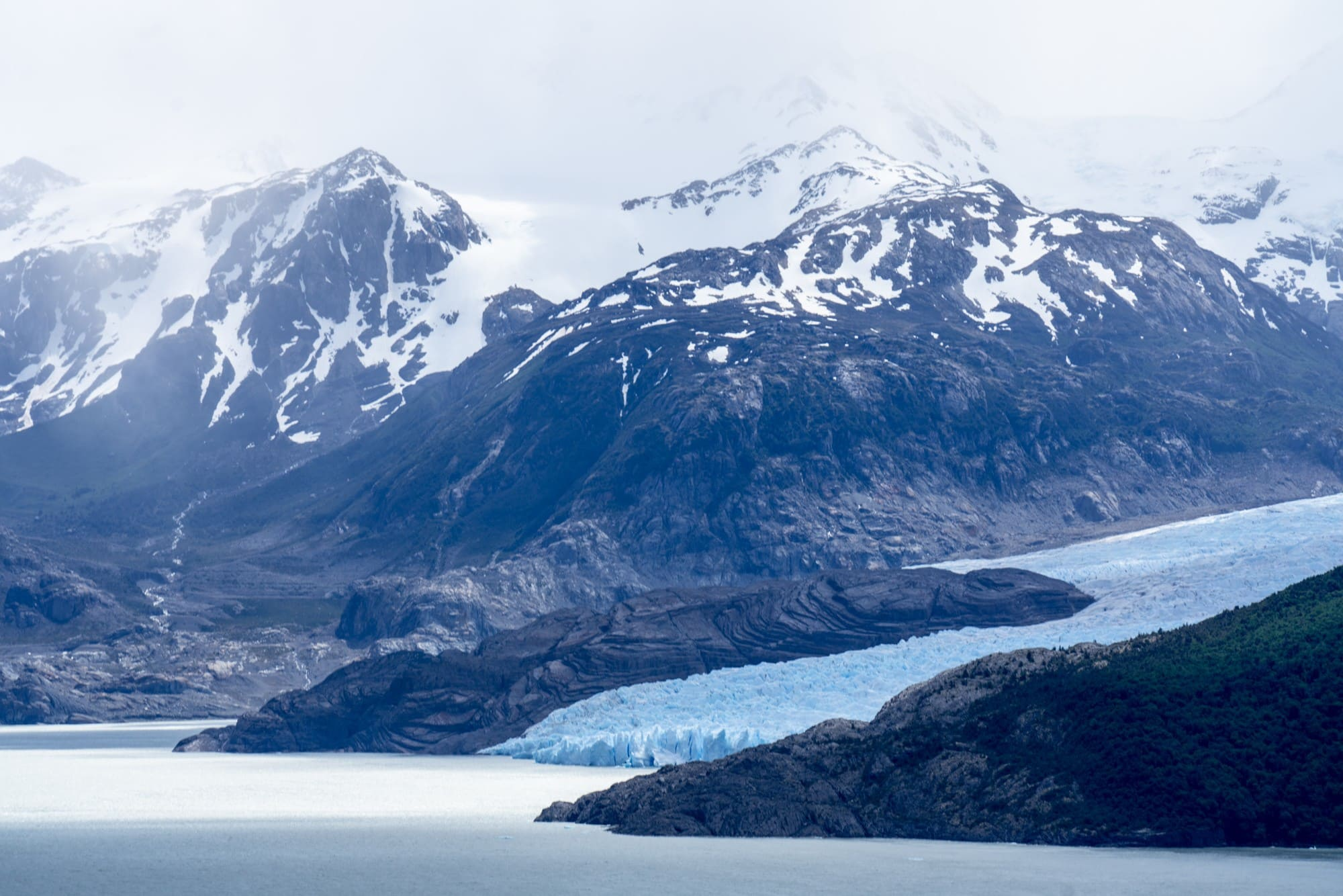 Grey Glacier // Want to hike the W Trek in Torres Del Paine? We answer all of your questions about itineraries, gear, campsites, and whether a guide is necessary.