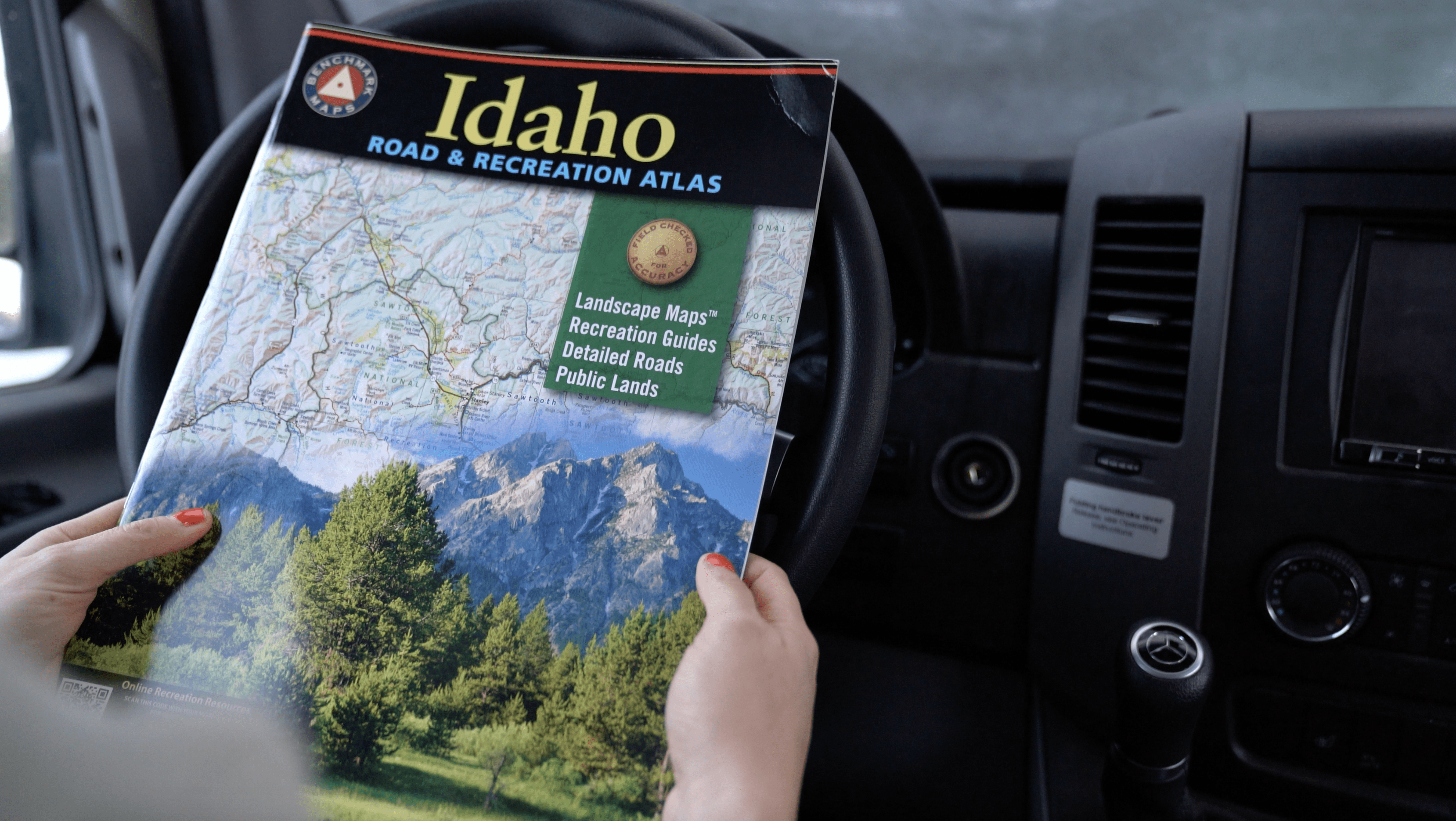 Benchmark Road Atlas // This complete road trip essentials packing checklist for adventure travelers includes everything you need for an epic trip.