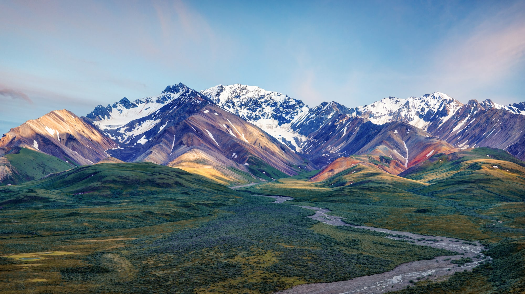Denali National Park makes the roundup of 14 amazing domestic & international travel destinations at the top of our adventure bucketlist for 2019.