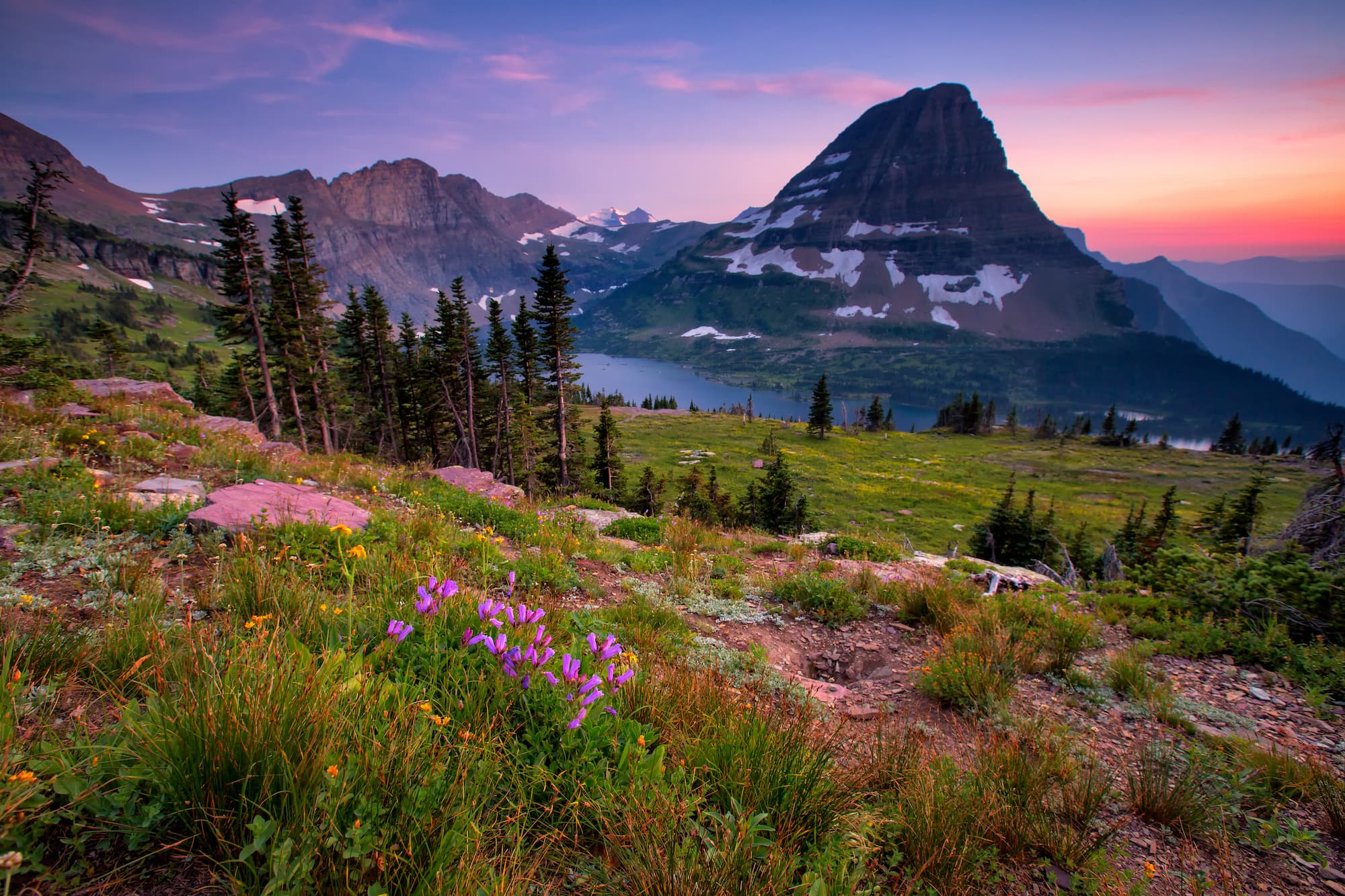 Glacier National Park makes the roundup of 14 amazing domestic & international travel destinations at the top of our adventure bucketlist for 2019.