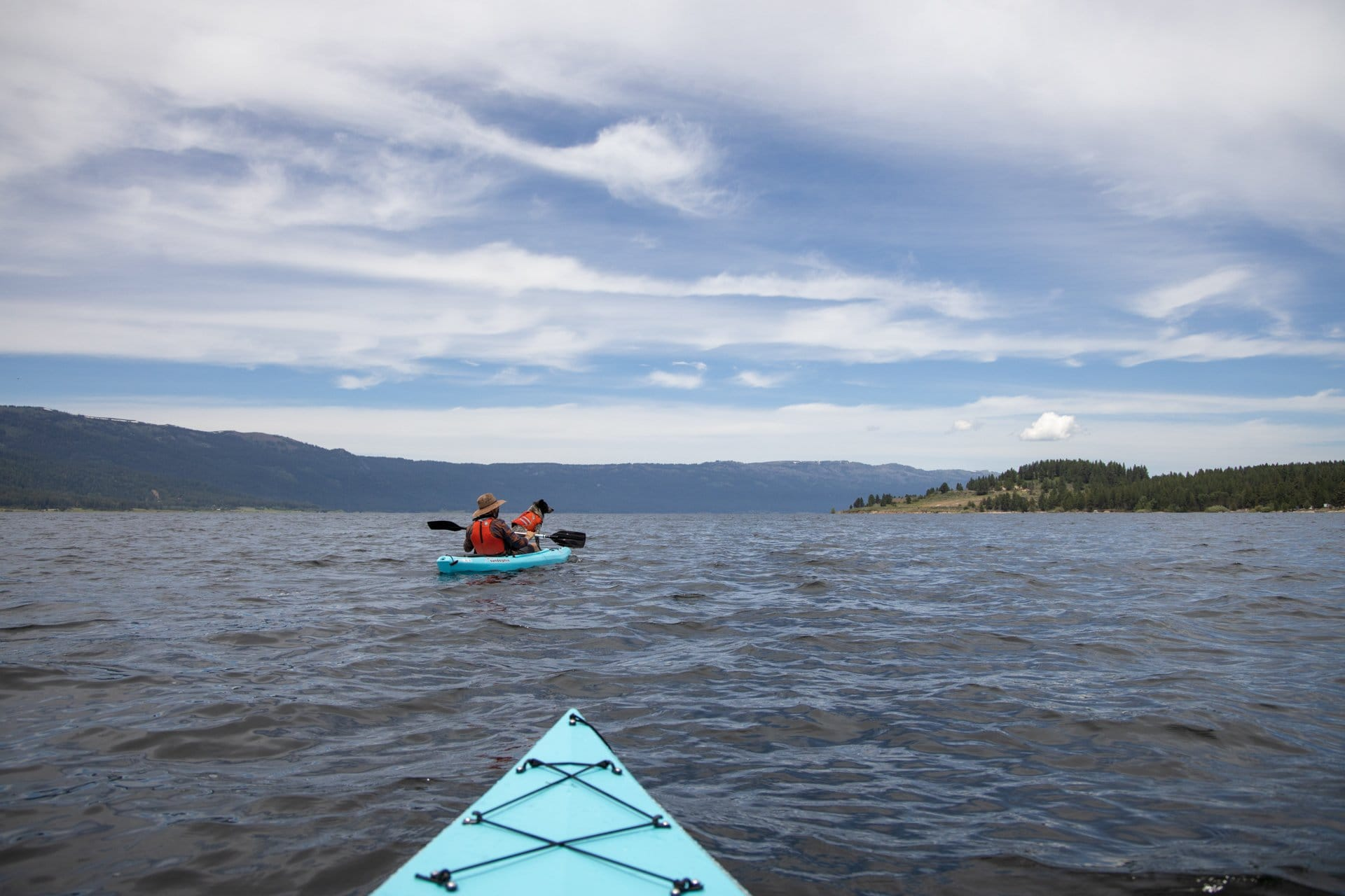 Kayaking on Lake Cascade // Explore the best outdoor recreation in Cascade, Idaho with this 4-day itinerary featuring hot springs, hiking, off-roading, biking, and more.
