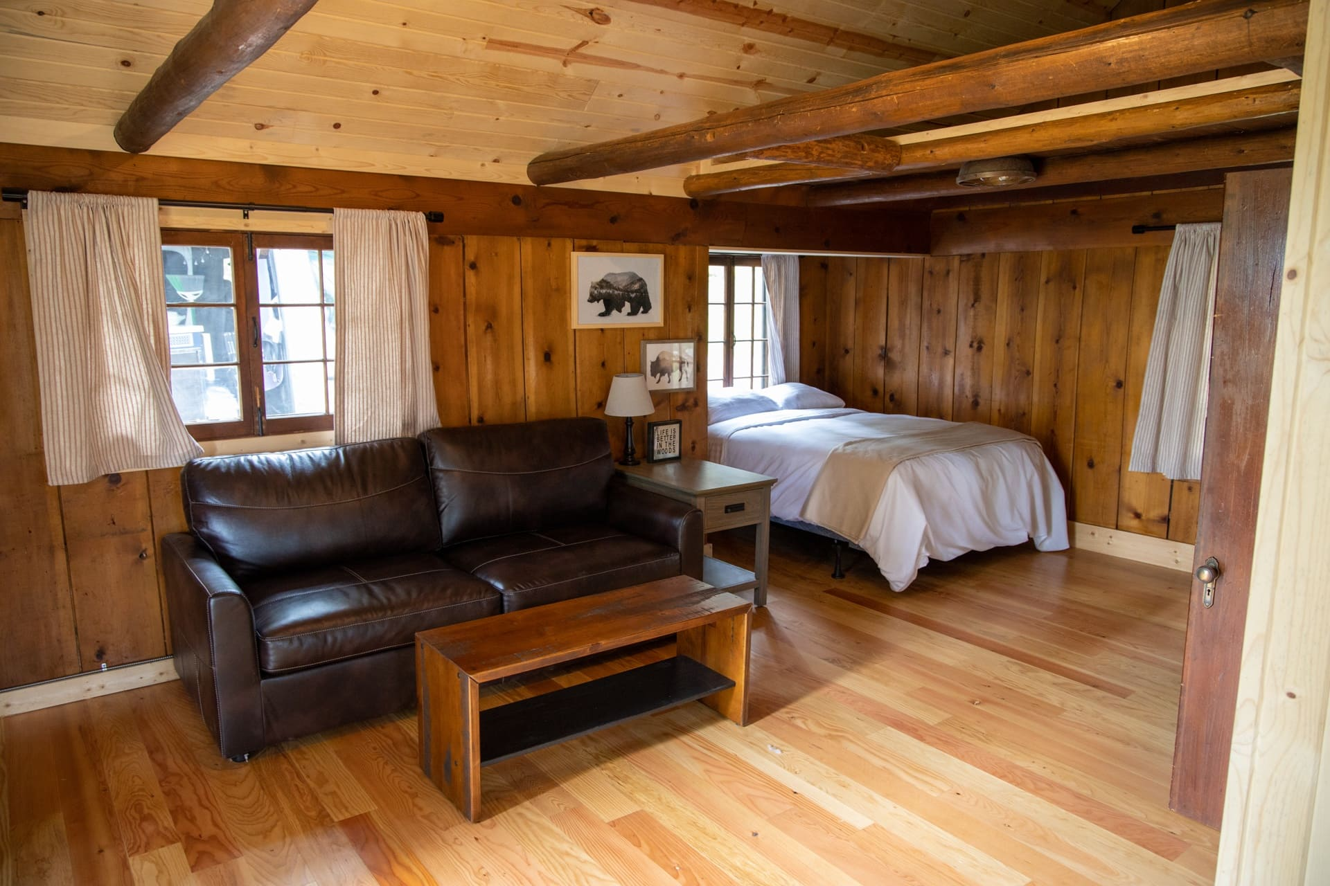 Plan a relaxing getaway to a cozy cabin at Cascade Idaho's Warm Lake Lodge where you can paddle board, boat, birdwatch, soak in hot springs & more.