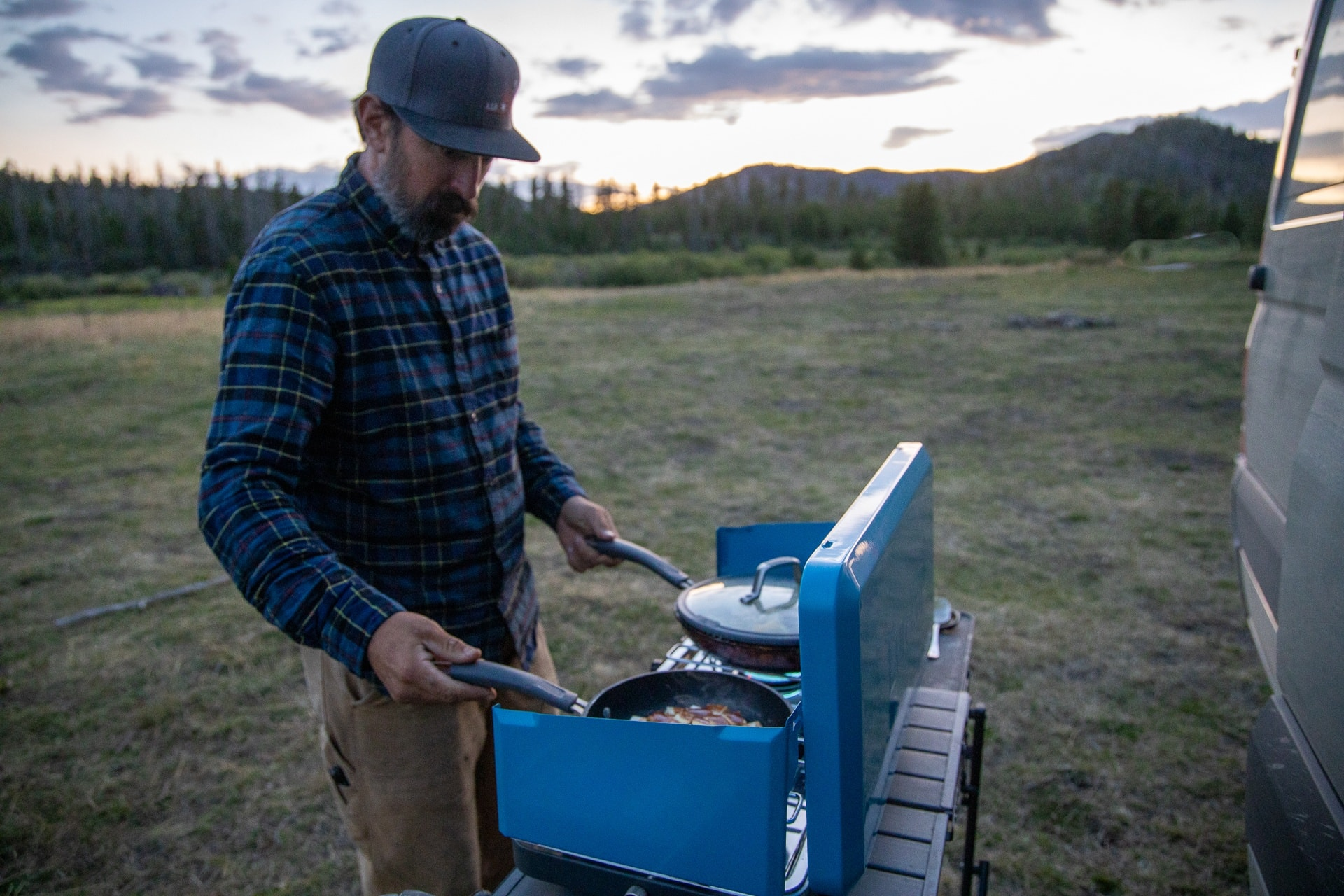 Eureka XL Camp Stove // Save money on the road by bringing your own camp cooking gear. Here is our checklist for the best outdoor camp kitchen cooking essentials.