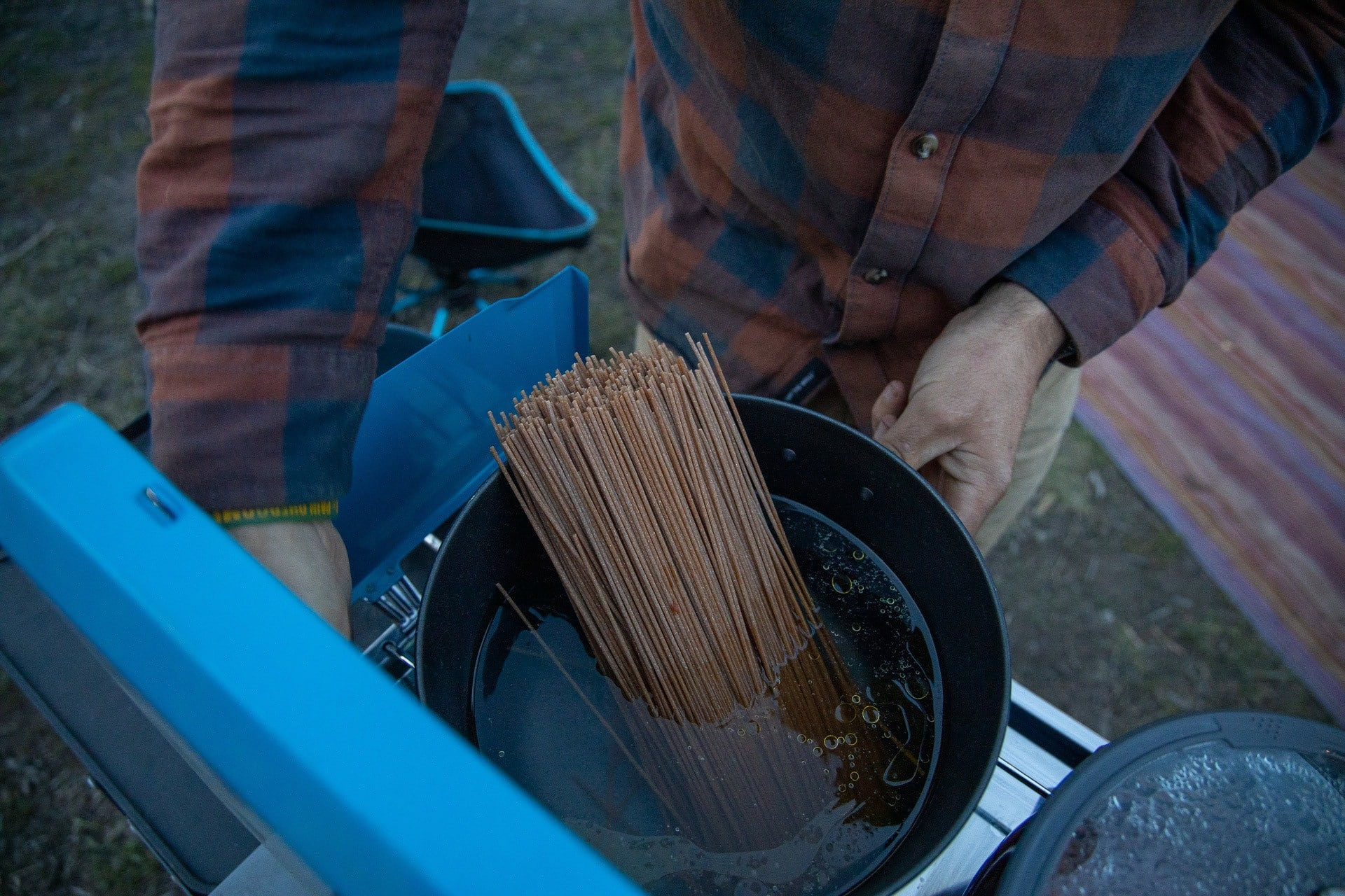 GSI Cookset // Save money on the road by bringing your own camp cooking gear. Here is our checklist for the best outdoor camp kitchen cooking essentials.