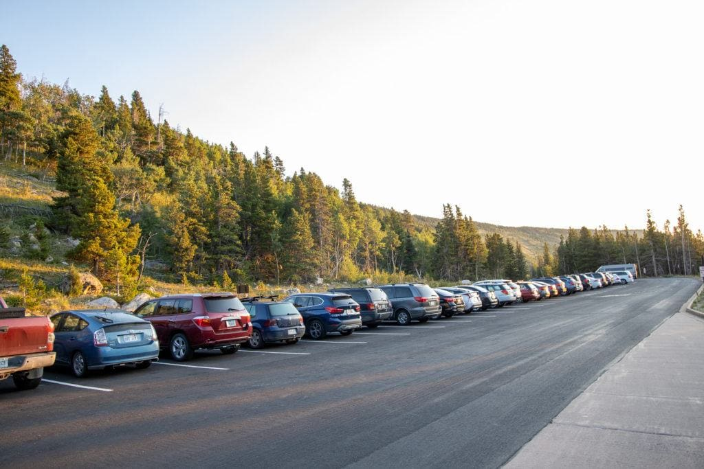 Glacier Gorge Parking Lot // Get our top tips for visiting Rocky Mountain National Park including when to go, where to camp, hiking tips, how to beat the crowds, and more.