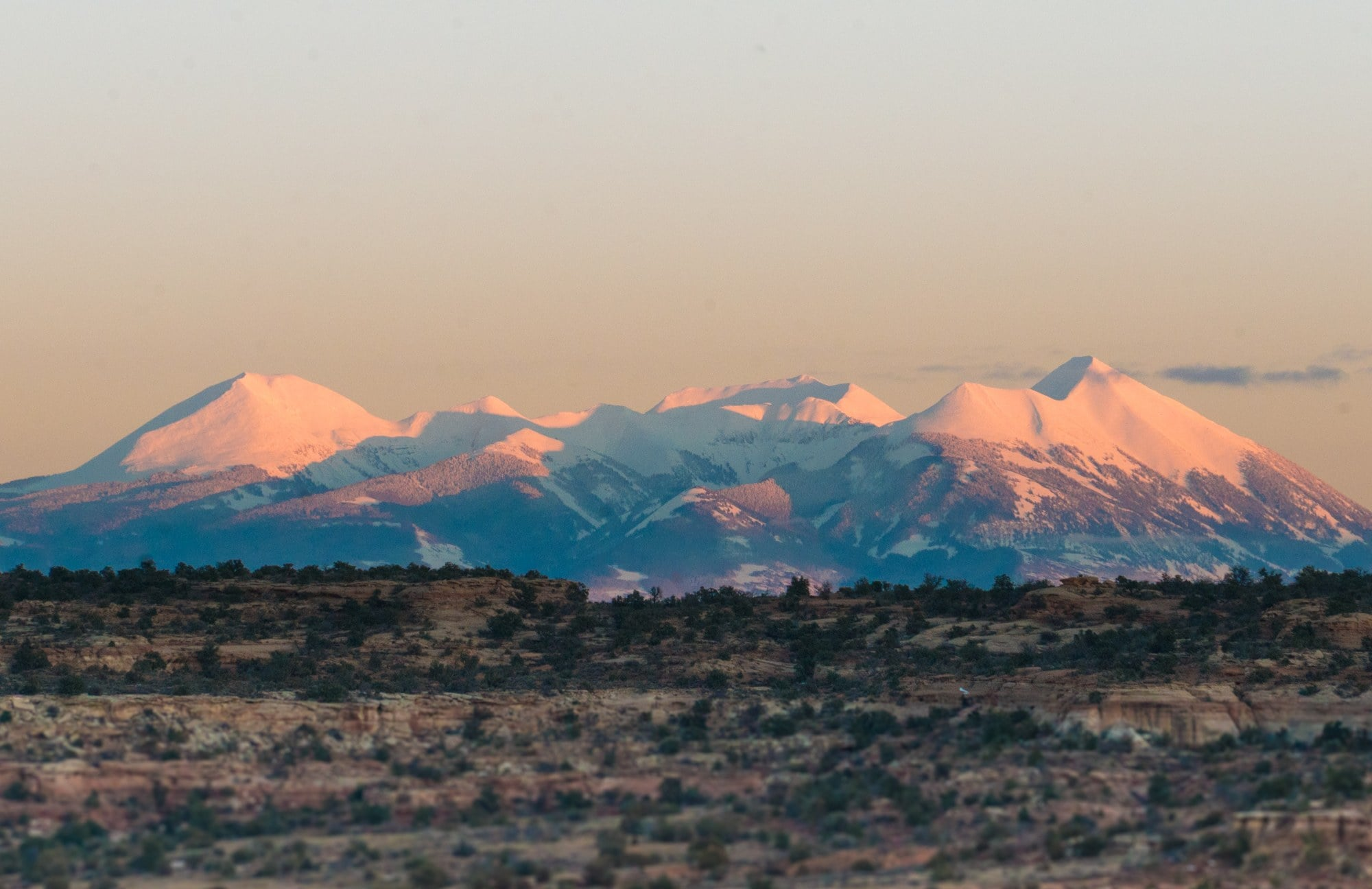 View of La Sal Mountains from Moab // Use these tips to learn how to do Moab like a local and be a responsible visitor while hiking, camping, off-roading and more.