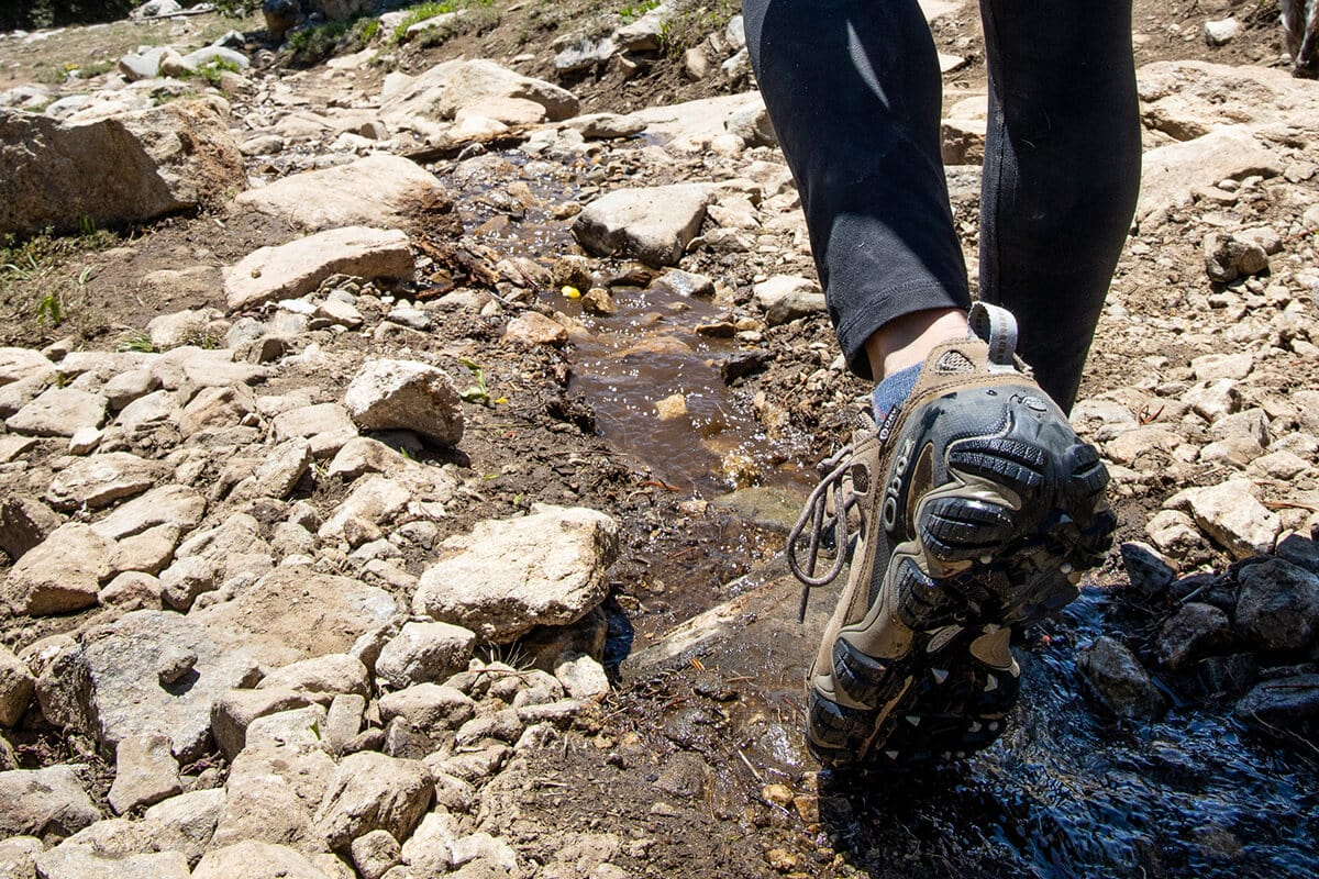 Should your hiking boots be waterproof? Learn the difference between waterproof vs non-waterproof hiking boots and which ones you need.