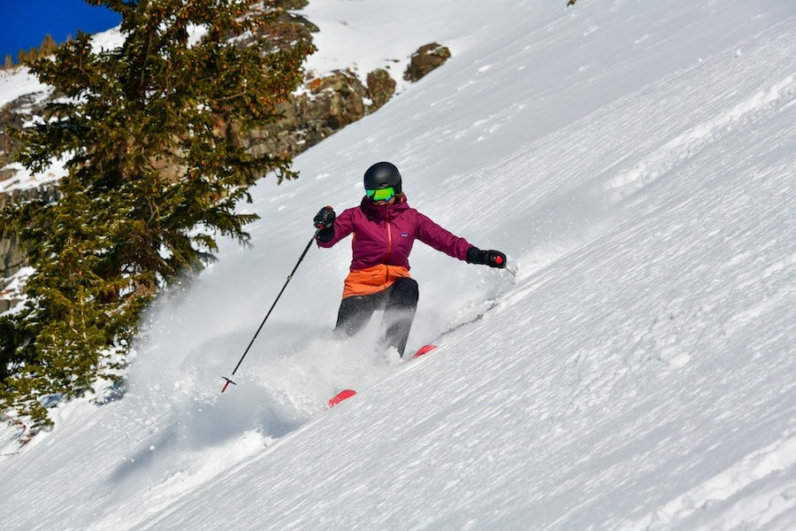 Learn what to wear skiing with this complete guide to skiing apparel including everything you need to be comfortable and warm on the slopes.