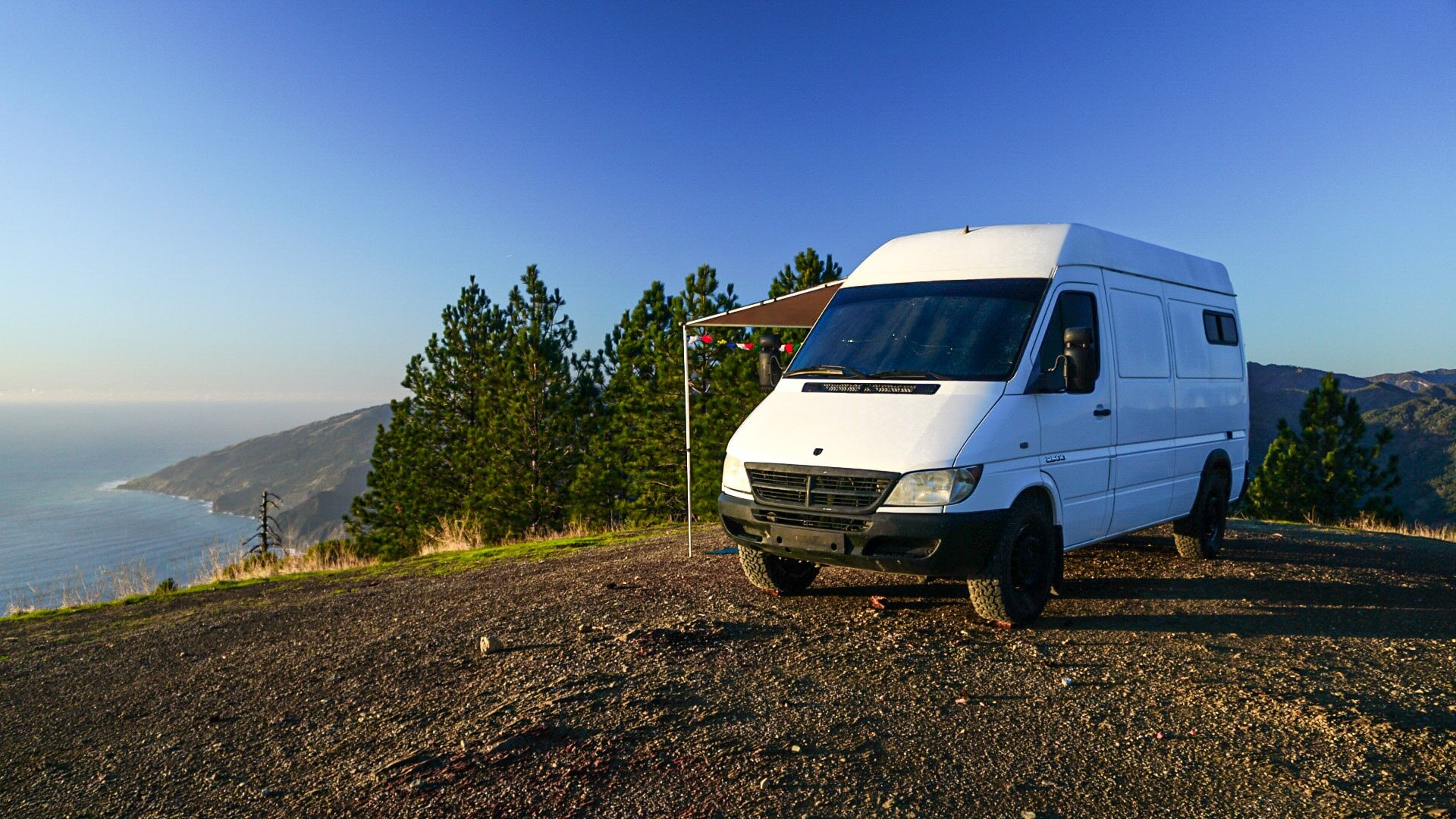 Camper Van Parked on Durable Surface // Is van life sustainable? Check out this blog post for environmentally-friendly tips on how to reduce your impact as an eco-friendly van lifer!