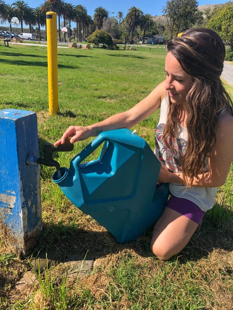 Van Lifer Refilling Water Jug // Is van life sustainable? Check out this blog post for environmentally-friendly tips on how to reduce your impact as an eco-friendly van lifer!