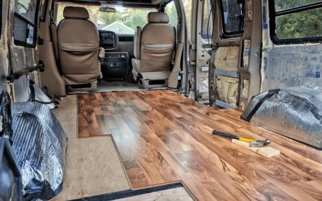 Building out a van? Whether DIY or hiring a conversion company, here's what to consider when picking out and installing van flooring + some popular options.