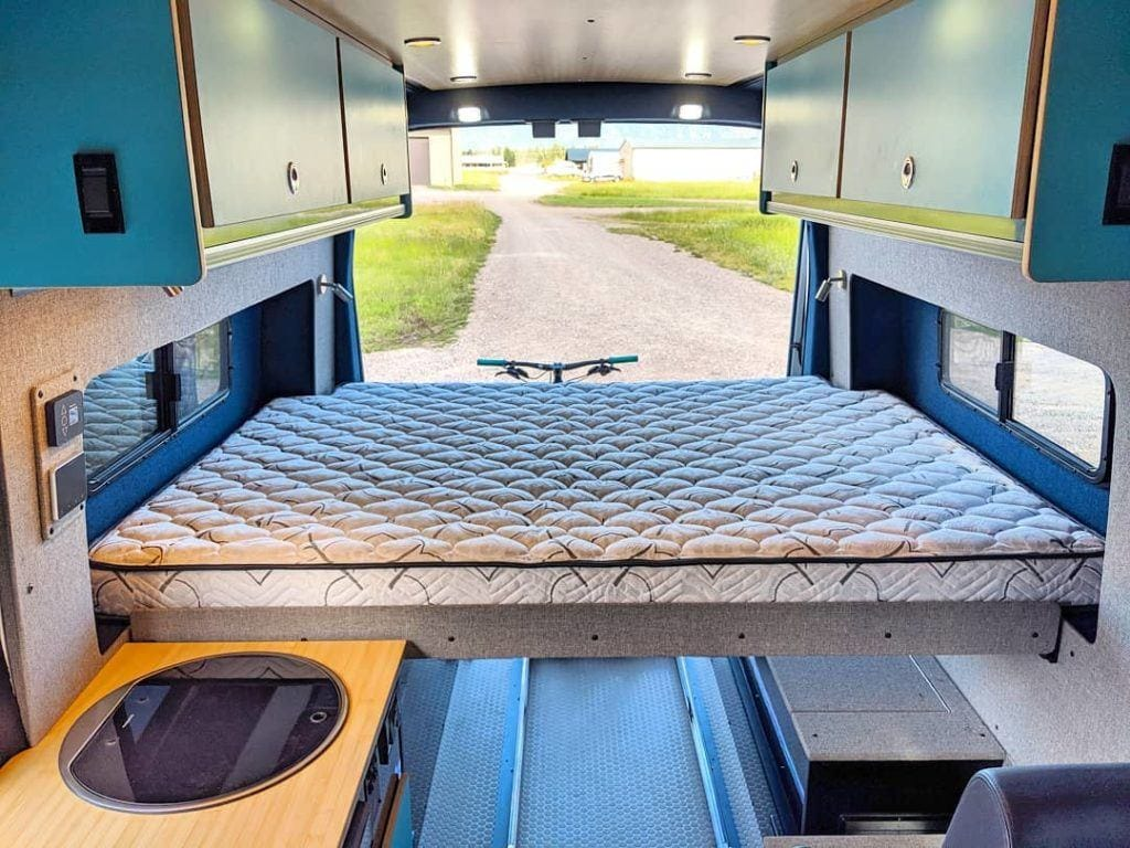 Example of a platform van bed using flares // Decide what bed style is right for your van conversion, whether a fixed platform bed or a convertible folding van bed plus the pros and cons of each.