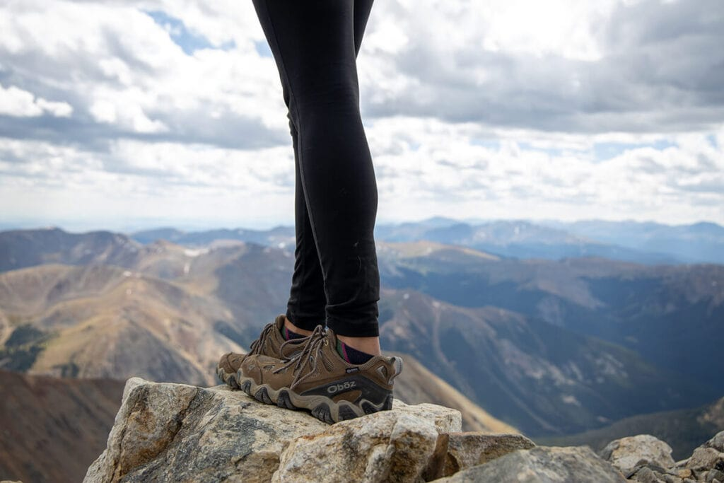 Not sure what to wear hiking? Learn how to dress for both function & comfort on the trail with this women's best hiking clothes guide.