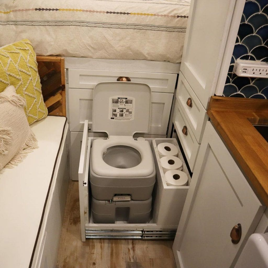 Hidden camper van toilet by @lightravelers