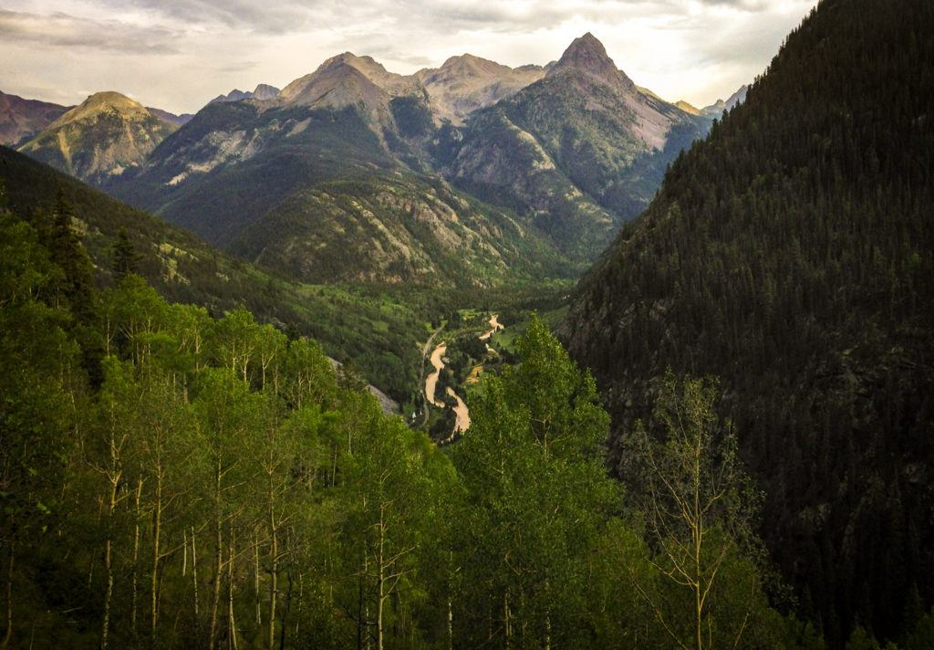 Vestal Peak and the Animas River // Experience vibrant fall Colorado colors with this road trip itinerary that takes you through some of the best aspen groves in the state.
