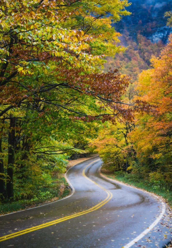Smuggler's Notch Road // Plan your Vermont Fall Foliage road trip with our guide on where see the best fall colors including scenic leaf-peeping drives and more.