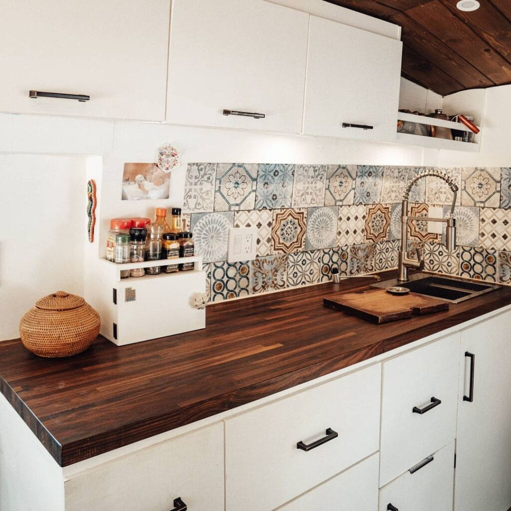 Van kitchen by @asobolife / Check out these camper van galleys for ideas on layout, appliances, storage, and more