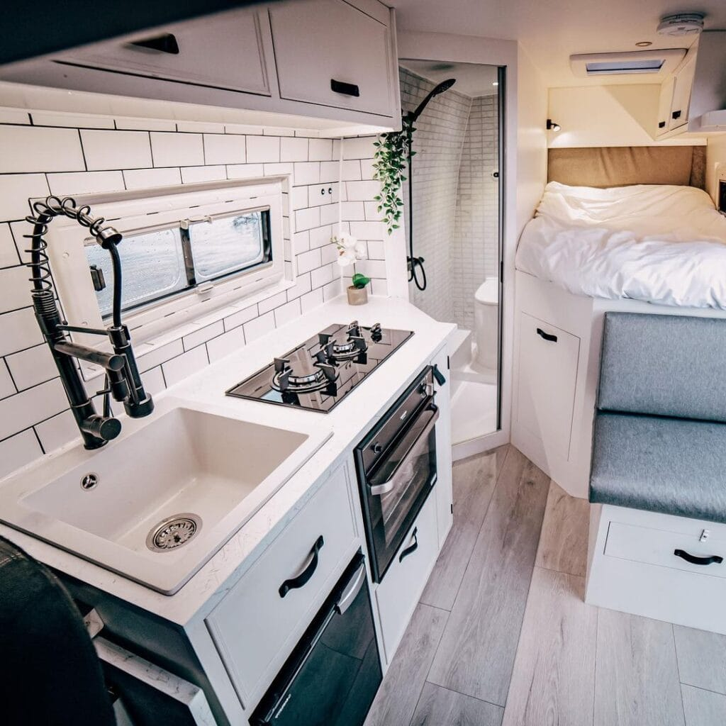 Van kitchen by Escape Conversions / Check out these van galleys for ideas on layout, appliances, storage, and more
