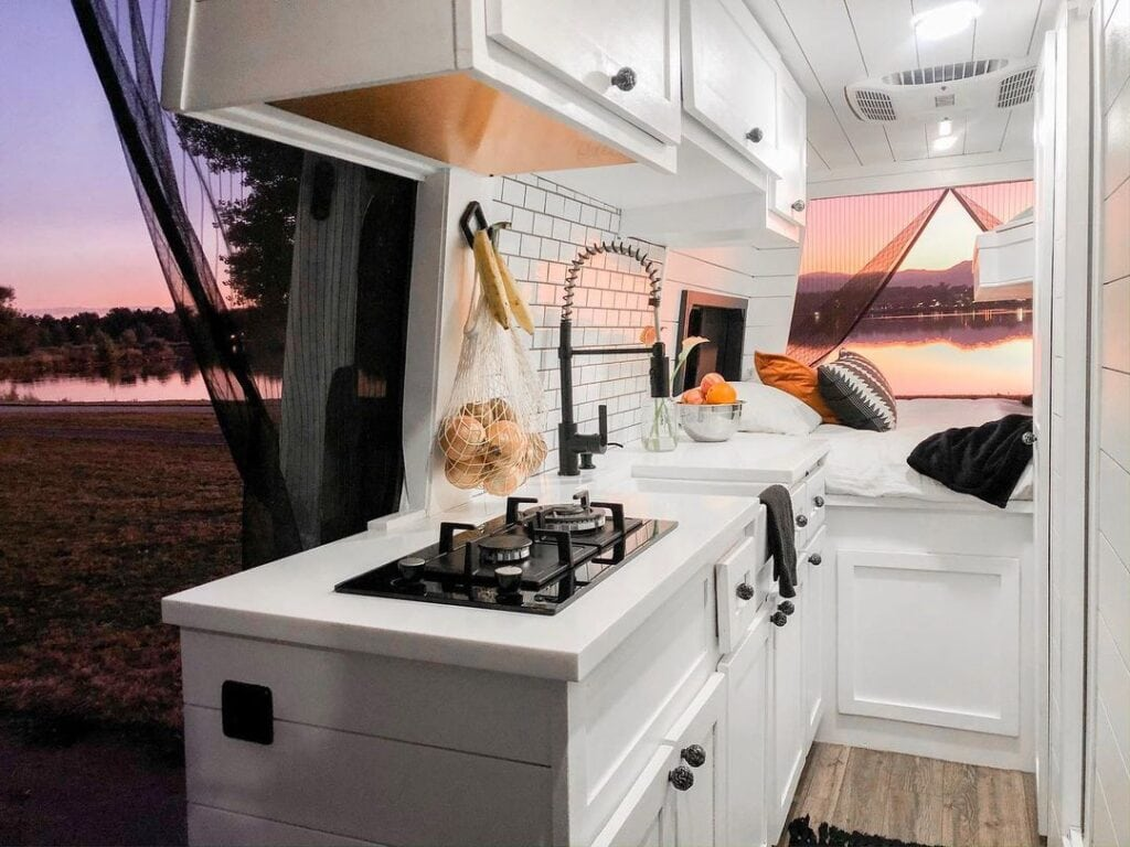 Mobile kitchen by @ourvanquest / Check out these van galleys for ideas on layout, appliances, storage, and more