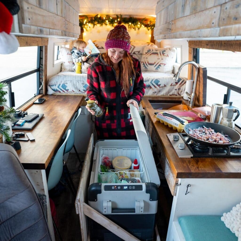 Van life kitchen by @rebornbyadventure / Check out these van galleys for ideas on layout, appliances, storage, and more.