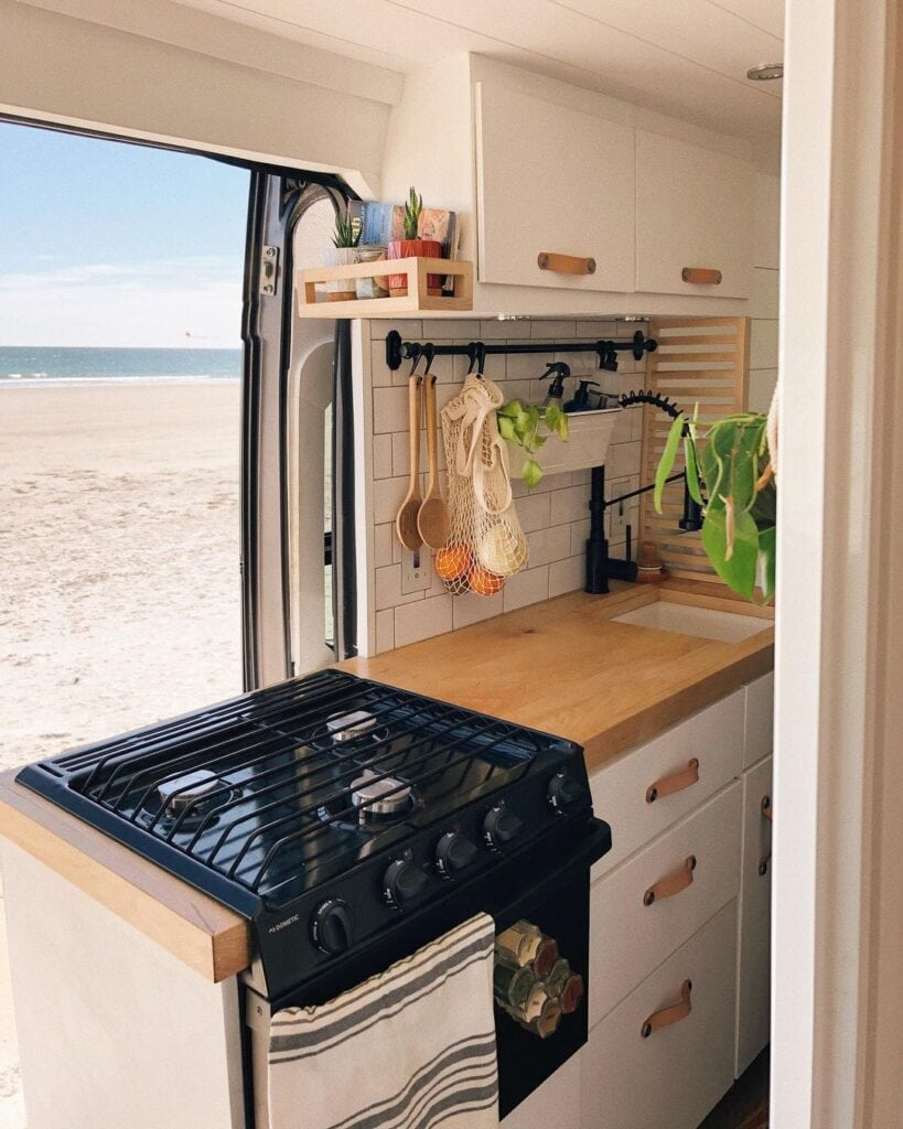 Camper van kitchen with an oven by @thehuntersvanlife / Check out these van galleys for ideas on layout, appliances, storage, and more