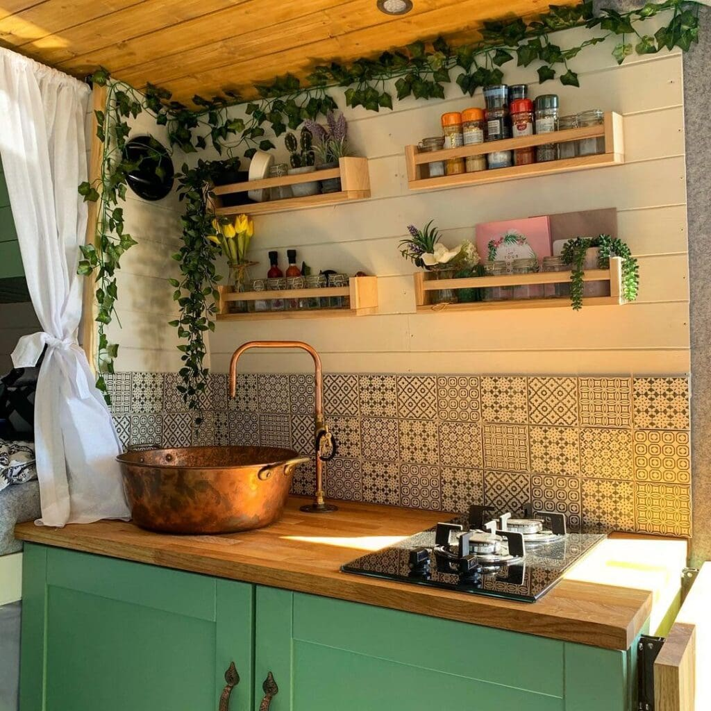 Van kitchen by @thetravelbobbers / Check out these van galleys for ideas on layout, appliances, storage, and more