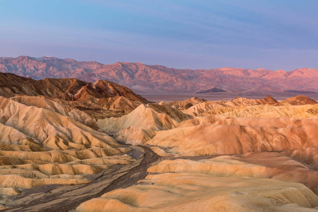 Zabriskie Point // Experience the best attractions in Death Valley National Park like sand dunes and salt flats with this 3-day Death Valley itinerary.