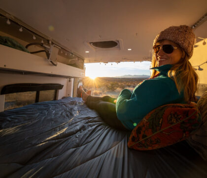 Curious about van life? Learn how to live in a van with tips on van conversions, downsizing, making money as a van lifer, and more.