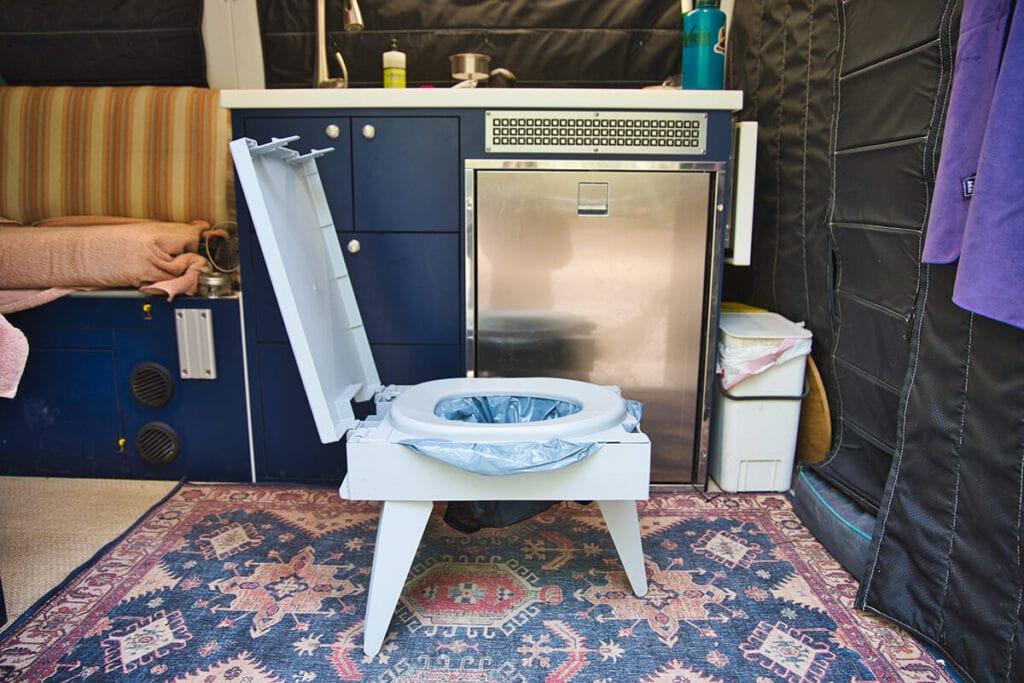 Portable toilet option for camping and van life / Know how to poop outdoors, pack out toilet paper, and stay clean when camping or backpacking so you can Leave No Trace outside.