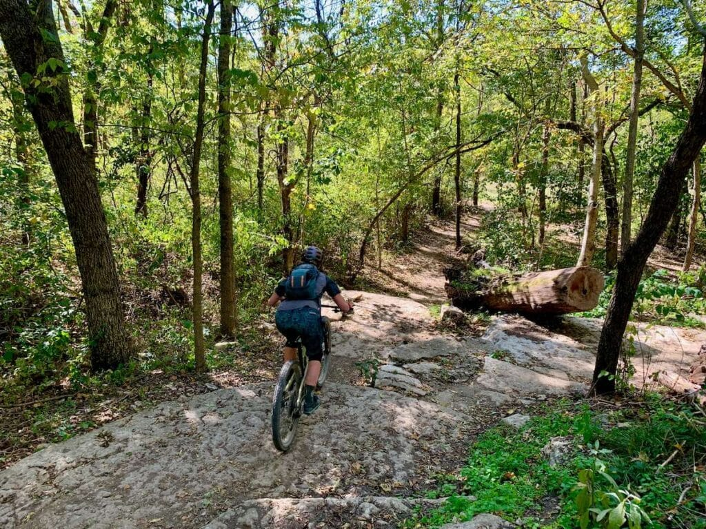 Bentonville // Discover the best e-bike trails in the US for mountain biking. From flowy singletrack to cross-country terrain, there are trails for everyone.